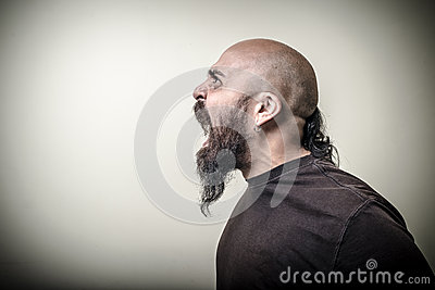 Profile screaming angry bearded man