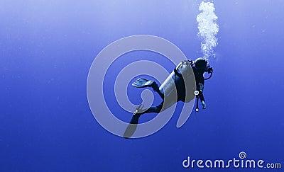 Profile of scuba diver with bubbles