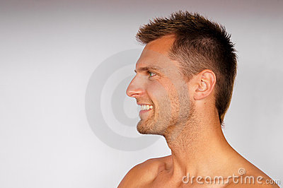 Profile of smiling young man.