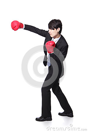Profile of successful businessman punching