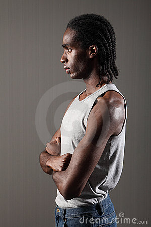 Profile of tough young black man with dreadlocks