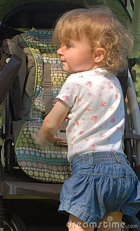 Profile of white toddler with long curly hair