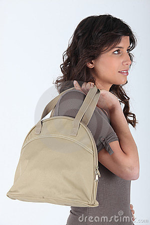 Profile of woman with bag