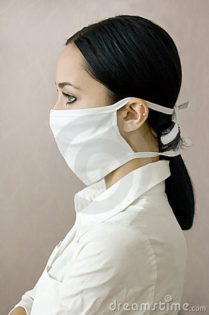 The profile of young girl in a medical mask