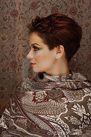 Profile of a young woman on fabric background