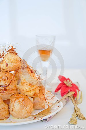 Profiterole, cream puff - French dessert choux pastry ball filled with ...