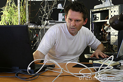 Programmer working on both computers