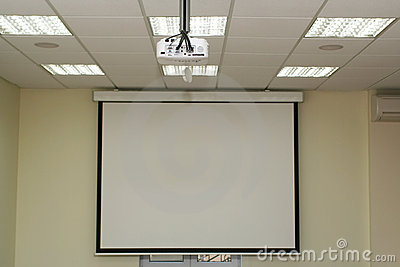 Projection screen in the boardroom with overhead projector