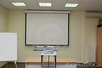 Projection screen in the boardroom with projector on table