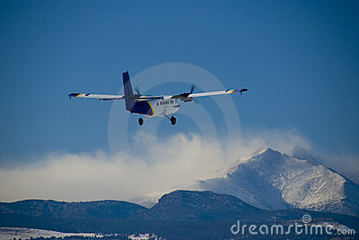 Prop Airplane Flying Over Mountains