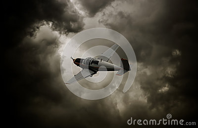 Propeller airplane with dark clouds