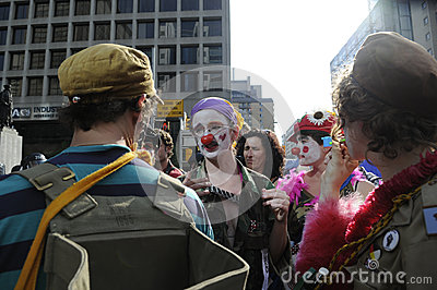 Protesters dressed as clowns. Editorial Photo