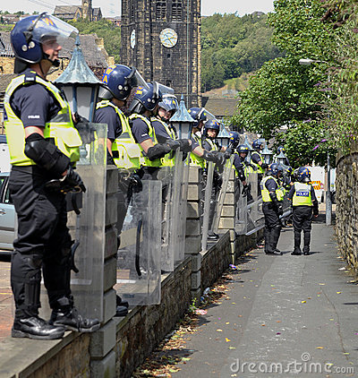 Protesters and police at a demonstration Editorial Stock Image