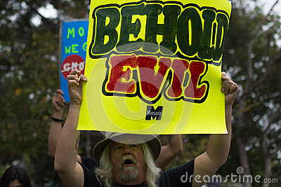 Protesters rallied in the streets against the Monsanto corporation. Editorial Stock Image