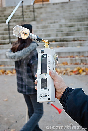 Protestor measures radiation from Videotron Antenn Editorial Image