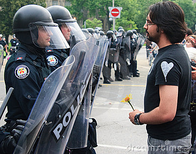 Protestor uses Flower facing Police G8/G20 Toronto Editorial Stock Photo