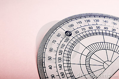 Protractor on pink background
