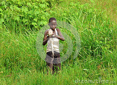 Proud African boy catches fish to feed family Editorial Photography