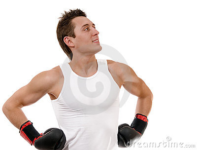 Proud boxer with boxing gloves after fight