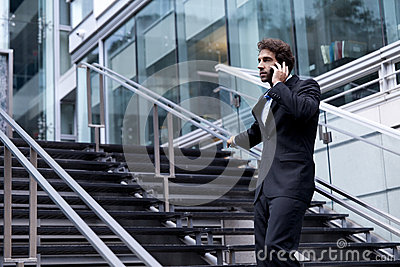 Proud Businessman on the Phone in front of his office