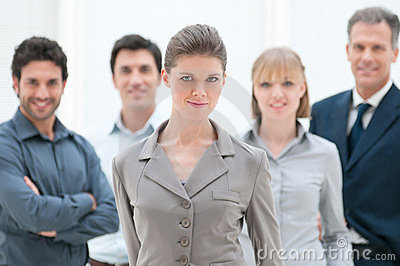 Proud businesswoman in group