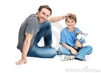 Proud father with his son holding a winning trophy