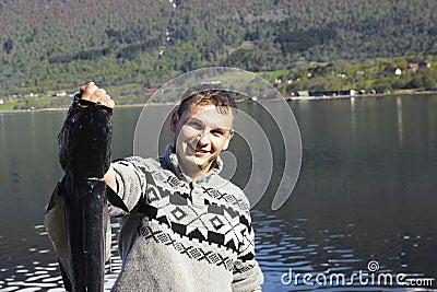 Proud fisherman displaying a large fish
