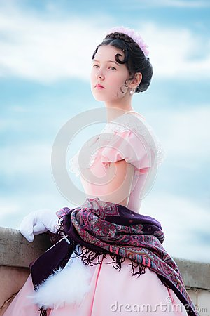 Free Proud Girl In The Image Of The Princess In An Evening Dress Stock Photography - 106629652
