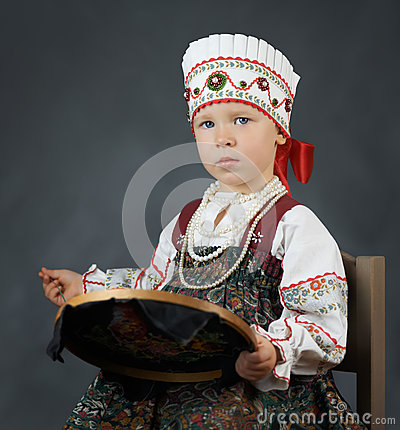 Free Proud Little Girl In The Traditional Russian Sarafan During Embroidering Stock Image - 80747091