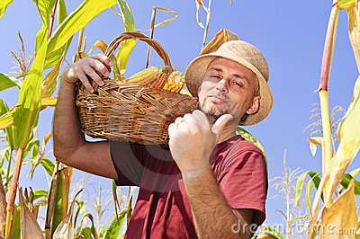 Proud man with maize basket