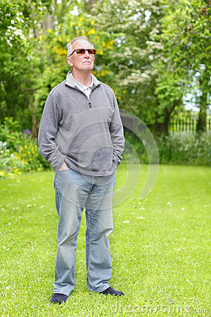 Proud old man on lawn