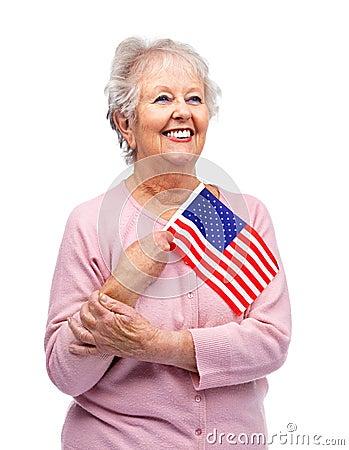 Proud senior female holding a flag of America