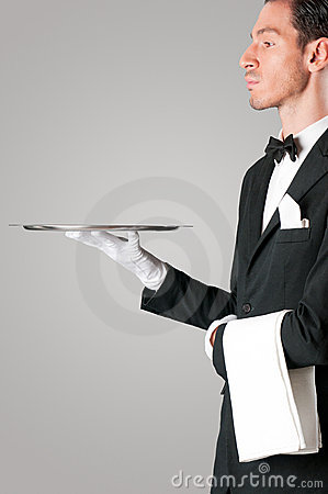Proud waiter serving with tray