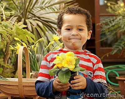 Proud young gardener and plant.