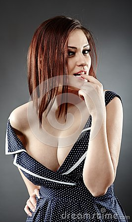 Provocative woman biting her finger