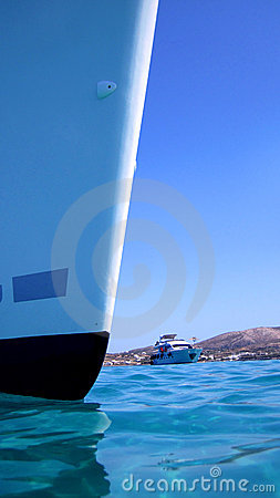 Prow of boat in blue sea