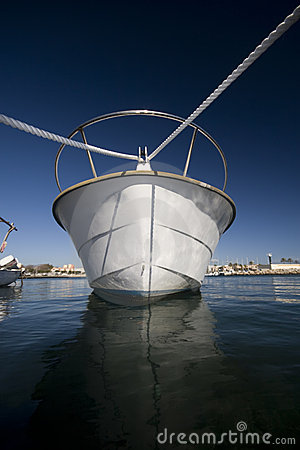 Prow of moored boat in harbor