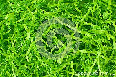 Påskgräs, vibrerande gräsplan som göras av strimlat krusat pappers-