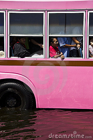 Public bus and passenger in flood Editorial Photography