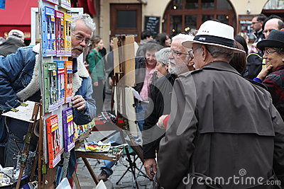 Public painter and buyer on Montmartre Editorial Photography