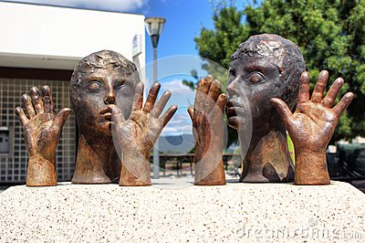 Public sculpture of hands and heads in Vila Nova de Cerveira