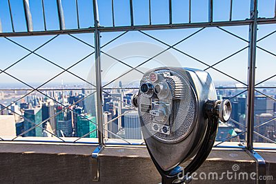 Public telescope pointed on Manhattan buildings
