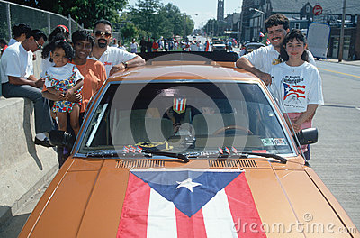 A Puerto Rican family with their flag draped car Editorial Stock Image