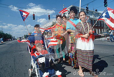 A Puerto Rican family with their national flag Editorial Stock Image