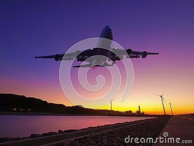 Puesta del sol y aeroplano