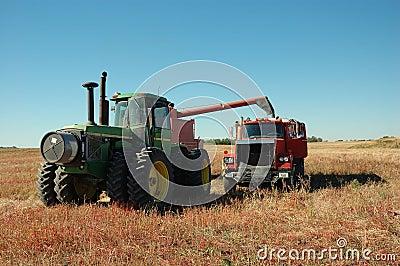 Pull Combine Dumping into Grain Truck