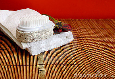 Pumice brush and towel at a spa - copy space
