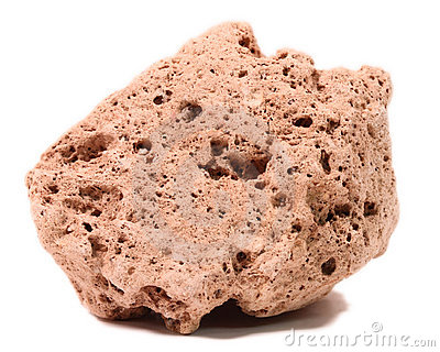 Closeup of porous pumice stone, white background.