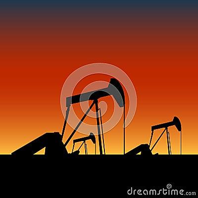 Pump jacks on oil wells at sunset