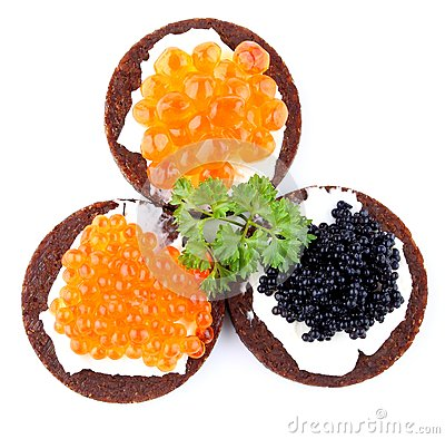 Pumpernickel bread topped with red and black caviar
